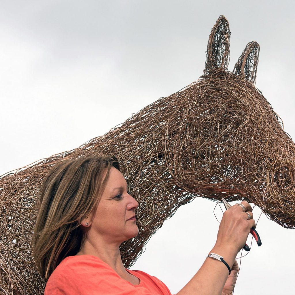 Emma Stothard unveils her golden horse at the Yorkshire Show